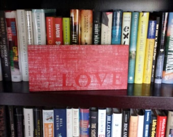 Small wooden sign to remind you that love is all you need.