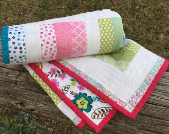 Bright fun flowery baby quilt