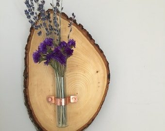 minimalistic wooden wall art with test tube vase