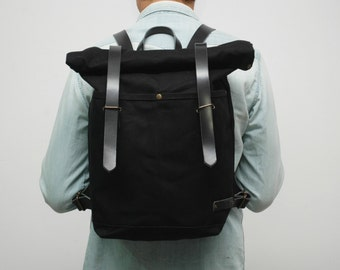 waxed Canvas rucksack/backpack,  black color, hand waxed , with handles, leather  double closures