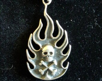 Sterling silver flaming skull and crossbones