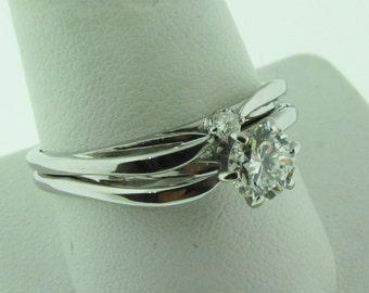 14 K white gold and diamond engagement and wedding set.