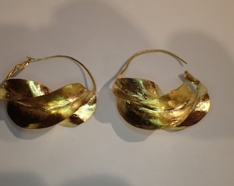 """African gold plated """"Fulani"""" earrings."""