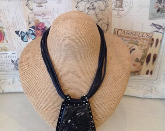Black strand necklace with large stone drop detail