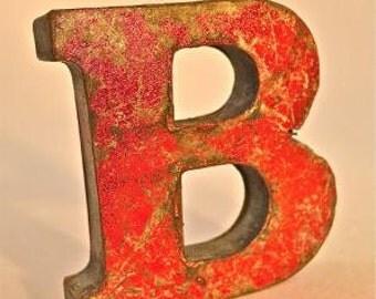 A fantastic vintage style metal 3D red B