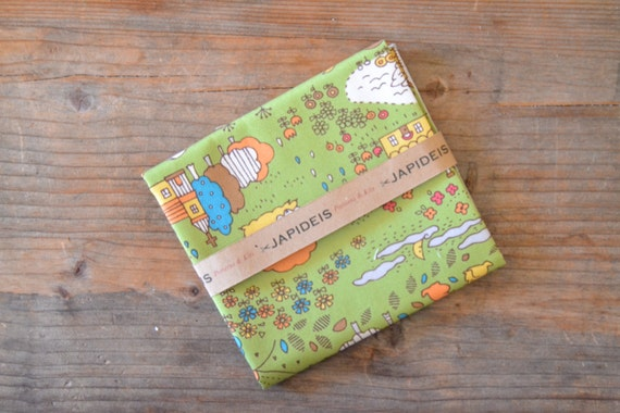 fabric fat quarter 50 x 55 cm of Kokka with drawing of forest and trees and animals