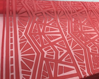 Red geometric retro pleather design on a mesh. Sold by the yard.