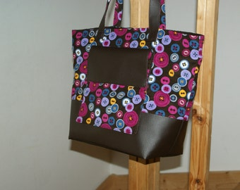 Printed velour button and faux brown leather bag-tote.