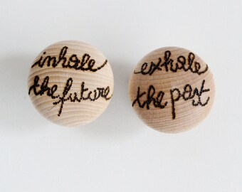Wood knobs with inspirational quote: Inhale the future, exhale the past!