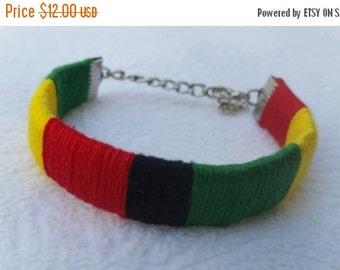 ON SALE Rasta themed woven bracelet.