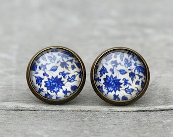 Studs with old porcelain Scene