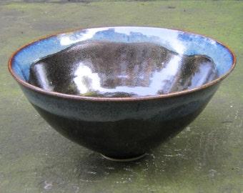 Handmade ceramic bowl with black and blue glaze