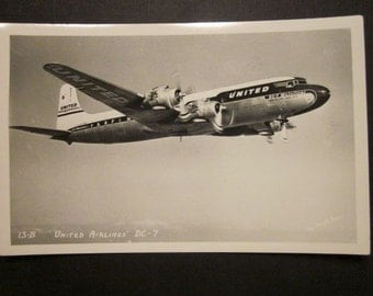 1957 George Enell RPPC of United Airlines DC-7 Mainliner #13-B