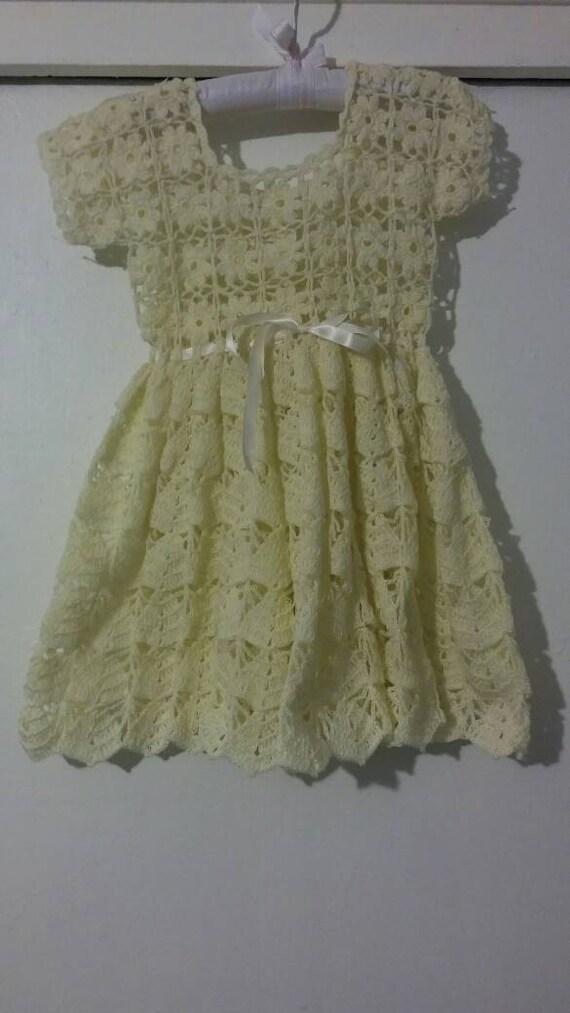Beige crocheted baby girl dress