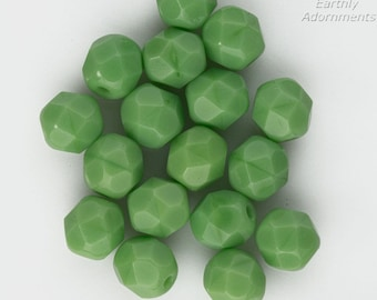Vintage West German opaque pressed mint green faceted rounds. 6mm. Package of 10. b11-gr-2032(e)