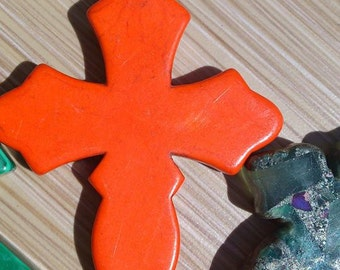 three inch orange cross.