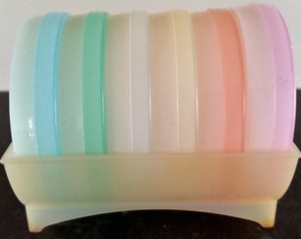 Six Retro Tupperware coasters pastel colours in a holder