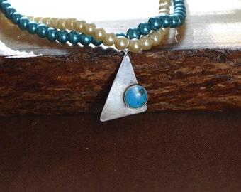 Geometric pendant and glass pearl necklace in teal and white