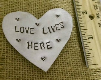 Love lives here hand stamped magnet
