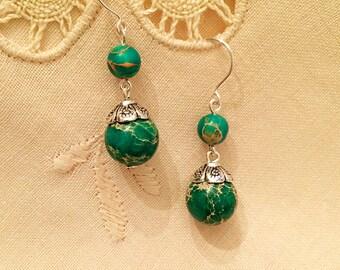 SALE--Dangling green howlite beads earrings handmade with tibetan silver.