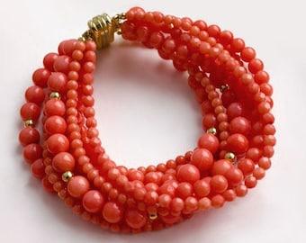 Multi strand bracelet with a salmon coral