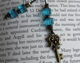 Blue beaded bookmark with gold key charm