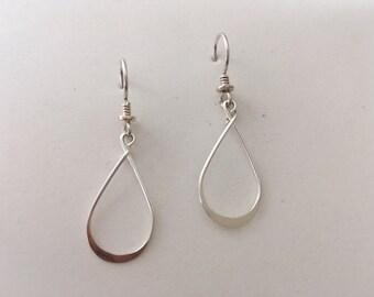 Delicate sterling silver loop dangle earrings.