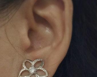 14 karat white gold Flower earrings with cubic zirconias stones.