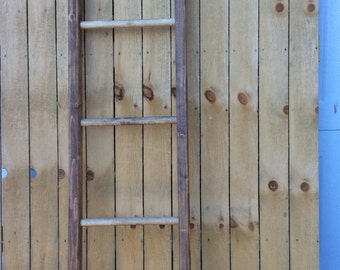 Decorative wooden ladders. Hand crafted pine, stained and distressed for a rustic look. Decorate for the seasons or a specific decor.