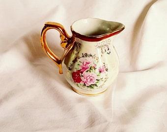 Gold trim cream pitcher
