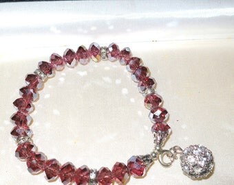 Beautiful pink purple aurora borealis crystal  bracelet