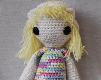 Multicolored crochet doll