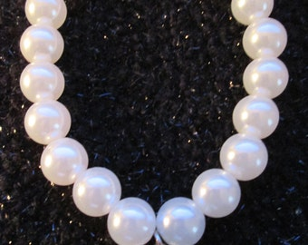 Silver Heart Charm Attached to a White Faux Pearl Stretch Bracelet