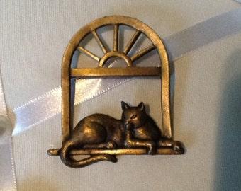 J.J.  Jewelry Cat in Window