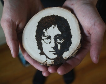 John Lennon wood-burned wall hanging