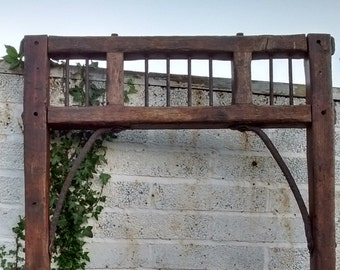 Garden arch way, porch entrance, French barn door entrance with traces of paint and hand forged features.