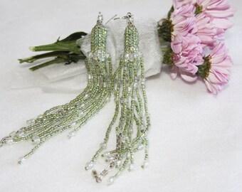 Pastel green fringe beaded earrings. Long pale green seed bead earrings. Elegant tender crystal dangle earrings Long boho beadwork earrings