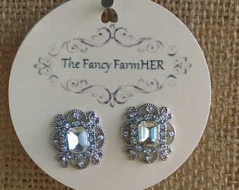 Silver finish and faux diamond button earrings