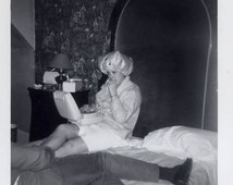vintage photo Young Teenage Girl Wearing Hair Dryer Man Out of Frame Lays on Bed w Her Mid Century 1960s
