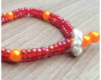 Crochet natural coloured silk bracelet with pink rainbow Miyuki seed beads and orange glass pearls DKD-sc-16-0011