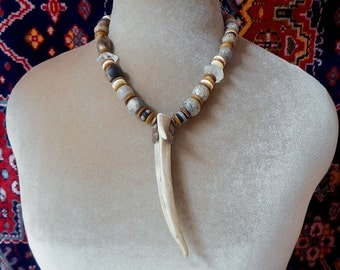 Deer Magic unusual antler, dinosaur bone beads and quartz crystal points