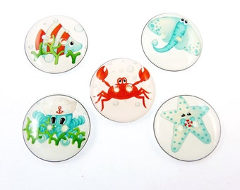 5 Sea Life Buttons.  Handmade buttons. 2 Hole.  Fish, Octopus, Stingray, Crab and Starfish  Handmade by Me.  Washer and Dryer Safe.