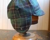 Flapjack M: winter cozy earflap hat in green plaid wool tweed