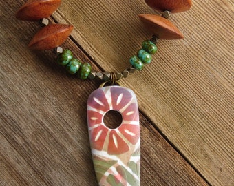 Polymer Clay Pendant featuring Tropical Flower Design in Red, Lime Green and Tan