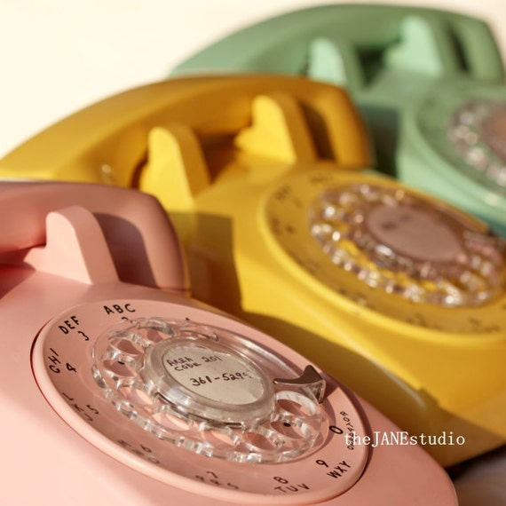 ring, ring, ring, PHOTOGRAPH, vintage rotary telephone, bakelite phone, retro, MCM, pink telephone, aqua, yellow, pastel, bedroom, apartment