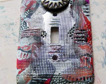 Got My Eye on You, switch plate cover, abstract design in polymer clay, pink, red, orange, black, white, silver, one of a kind