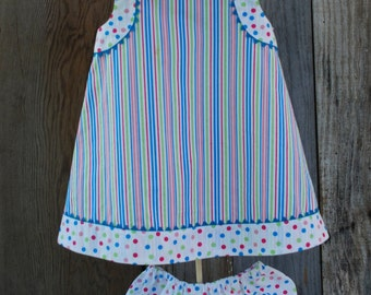 Girl's dress/jumper with hat and bloomers