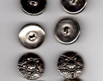 Matching set of  vintage 8 silver-tone decorative buttons