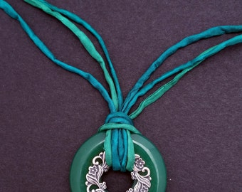Semi Precious Stone Donut Pendant with Floral Ring and Hand Dyed Green Silk Ribbons.