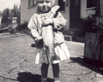This Is Not How To Hold A Fish - It Makes Your Clothes Smell Funny Photo 1959